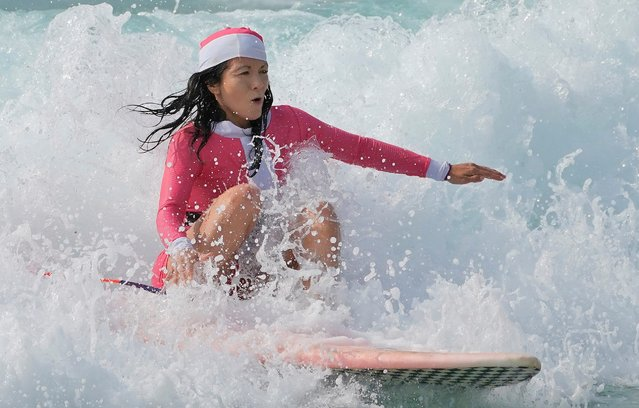 A girl wearing a Santa hat surfs at Bondi Beach on December 25, 2019 in Sydney, Australia. December is one of the hottest months of the year across Australia, with Christmas Day traditionally involving a trip to the beach and celebrations outdoors. (Photo by Mark Evans/Getty Images)
