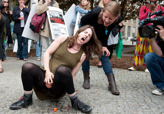 Midwifes simulate a childbirth as they stage a flashmob on May 5, 2012 in front of the Health Ministry in Berlin. They demonstrated against rising contributions to professional indemnity insurances
