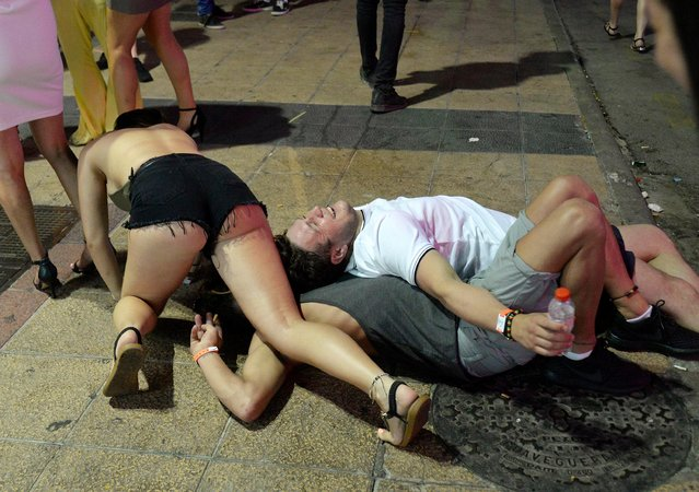British Holidaymakers seen partying partying in Punta Bella main Street in Magaluf, a major holiday resort on the Spanish island of Majorca this summer, July 2017. (Photo by Splash News and Pictures)