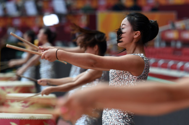 Drummers perform during rehearsals at the Bird's Nest National Stadium ahead of the IAAF Athletics World Championships in Beijing on August 20, 2015. The Athletics World Championships will be held at the stadium from August 22 to 30. (Photo by Greg Baker/AFP Photo)