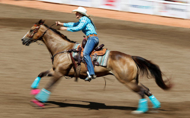 Taylor Jacob of Carmine, Texas, races in the barrel racing event during the Calgary Stampede rodeo in Calgary, Alberta, Canada July 8, 2016. (Photo by Todd Korol/Reuters)