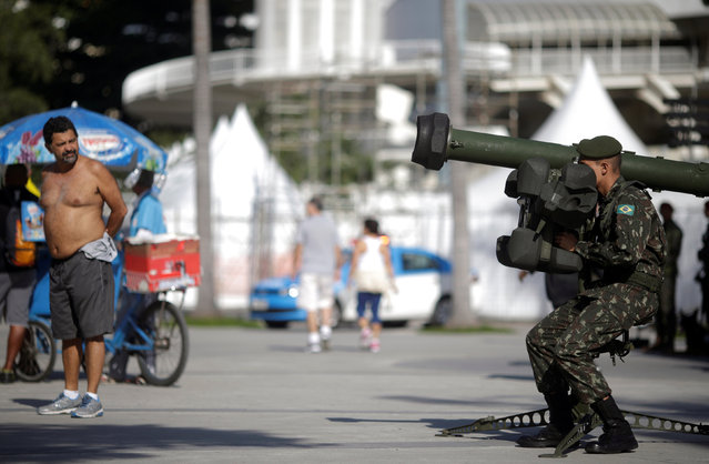 A Brazilian Army soldier attends a street patrolling exercise around the Maracana stadium ahead the 2016 Rio Olympics in Rio de Janeiro, Brazil, July 9, 2016. (Photo by Ricardo Moraes/Reuters)
