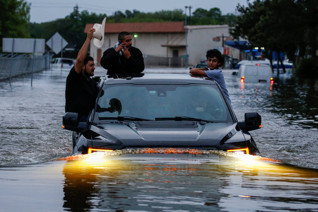 Residents use a truck to navigate through flood waters in Houston on August 28, 2017. (Photo by Adrees Latif/Reuters)
