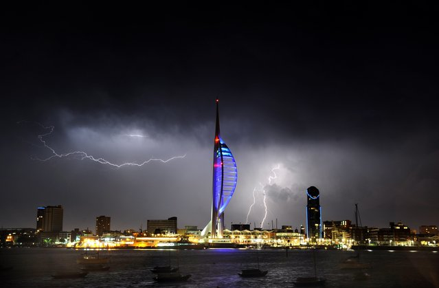 Electric lightning bolts ripped through the night sky last night in a striking finale to the year's hottest day. (Photo by Portsmouth News/Solent News & Photo Agency)