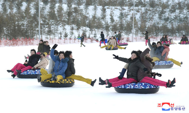 People play in the snow at the Yangdok Hot Spring Resort, North Korea, in this undated photo released on January 14, 2020 by North Korea's Korean Central News Agency (KCNA). (Photo by KCNA via Reuters)