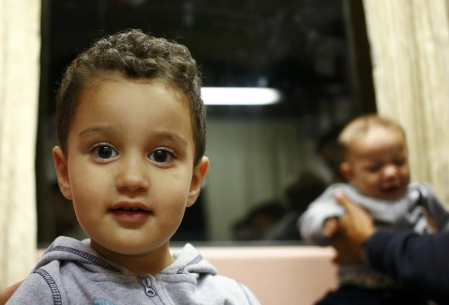 Syrian migrant children sit in a train en route to Hegyeshalom from the railway station in the town of Gyor, Hungary, September 5, 2015. (Photo by Leonhard Foeger/Reuters)