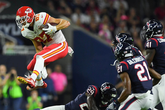 Kansas City Chiefs tight end Travis Kelce (87) jumps over Houston Texans free safety Andre Hal (29) during the first quarter at NRG Stadium in Houston, TX, USA on October 8, 2017. (Photo by Shanna Lockwood/USA TODAY Sports)