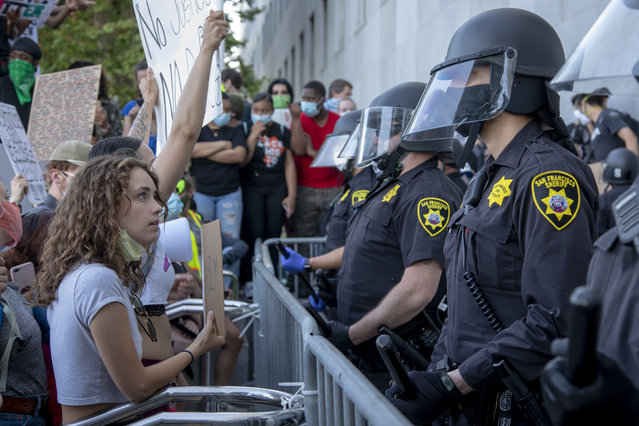 George Floyd protesters confront Sheriff deputies guarding the Hall of Justice in San Francisco, Calif., Wednesday, June 3, 2020. (Photo by Karl Mondon/Bay Area News Group)