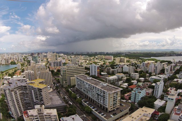 This September 23, 2014 photo, shows an aerial view of the Santurce neighborhood in San Juan, Puerto Rico. (Photo by Ricardo Arduengo/AP Photo)
