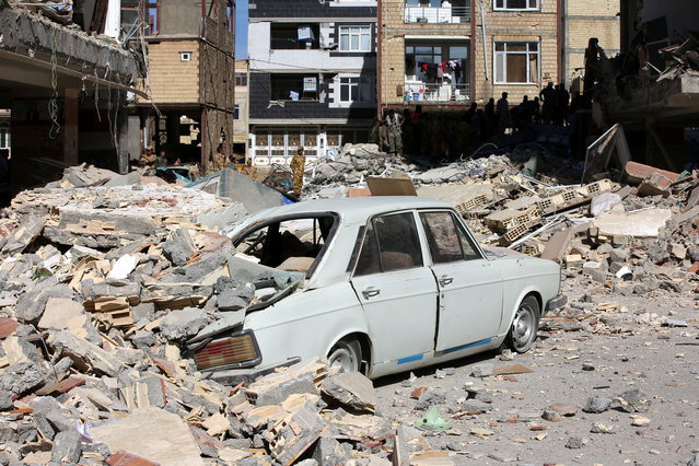 A car is trapped under the rubble in Sarpol-e Zahab town of Kermanshah, Iran on November 13, 2017 following a 7.3 magnitude earthquake that hit the Iraq and Iran. (Photo by Fatemeh Bahrami/Anadolu Agency/Getty Images)
