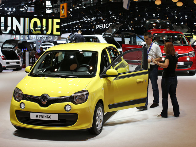 A new Renault Twingo car is displayed on media day at the Paris Mondial de l'Automobile, October 2, 2014. (Photo by Benoit Tessier/Reuters)