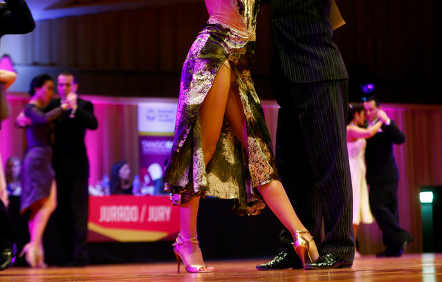 Couples compete in the Salon Tango style qualifier round at the Tango World Championship in Buenos Aires, Argentina, August 22, 2016. (Photo by Enrique Marcarian/Reuters)