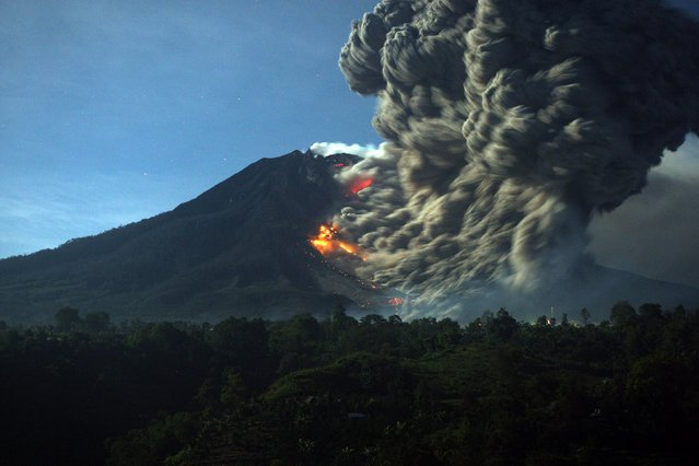 Mount Sinabung spews hot lava and volcanic ash as it is seen from Karo, North Sumatra, Indonesia, 09 October 2014. (Photo by Dedy Sahputra/EPA)