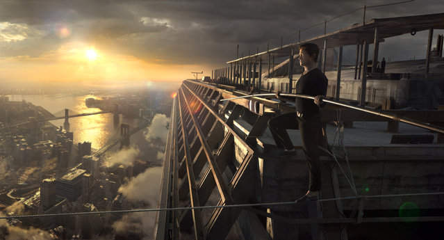 "In this image released by Sony Pictures, Joseph Gordon-Levitt portrays Philippe Petite in a scene from, ""The Walk"". The film, about high-wire artist Phillippe Petit's cabled walk between the Twin Towers in 1974, opens the 53rd New York Film Festival on Saturday. (Photo by Sony Pictures via AP Photo)"