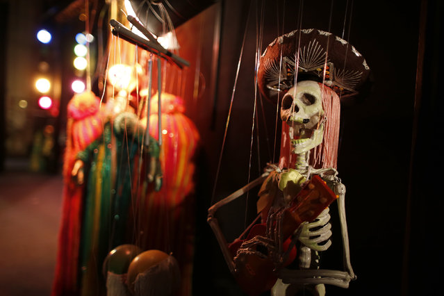 Marionettes wait backstage before a performance at the Bob Baker Marionette Theater in Los Angeles, California October 17, 2014. (Photo by Lucy Nicholson/Reuters)