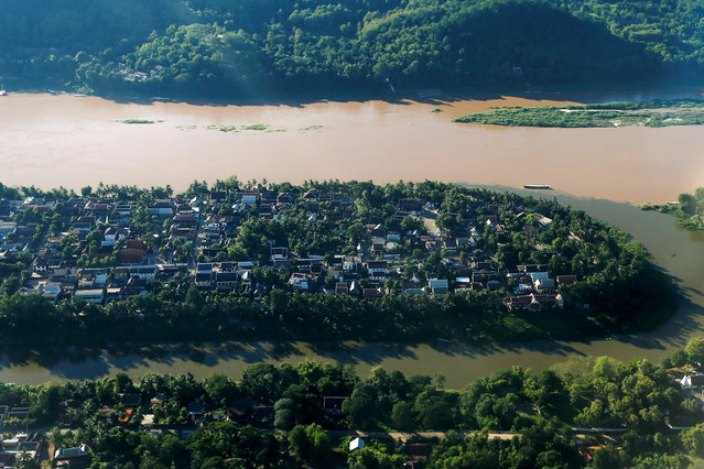An aerial view shows Luang Prabang between rivers Nam Khan and Mekong, Laos August 1, 2016. (Photo by Jorge Silva/Reuters)