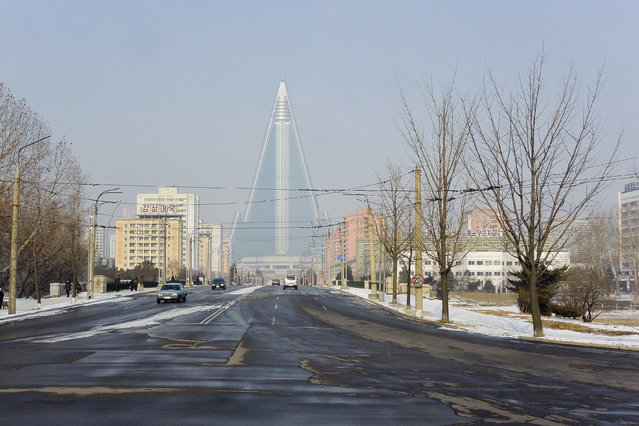 The brand-new Ryugyong hotel which started construction in 1987 and has not yet opened in February 2013, in Pyongyang, North Korea. (Photo by Andrew Macleod/Barcroft Media)