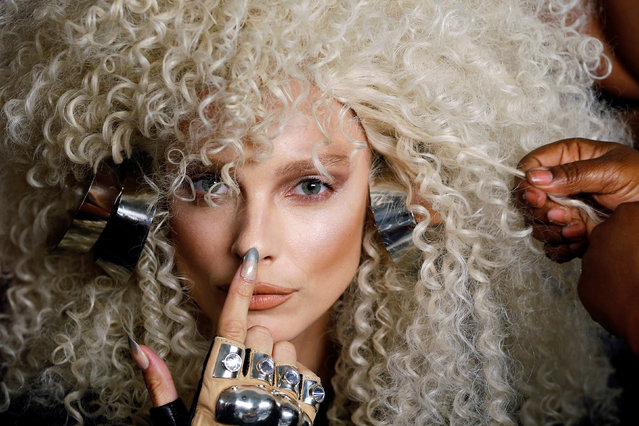 A model has a wig prepared backstage before The Blonds Spring/Summer 2017 collection during New York Fashion Week in the Manhattan borough of New York, U.S., September 11, 2016. (Photo by Lucas Jackson/Reuters)