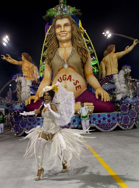 A dancer from the Mancha Verde samba school performs  in Sao Paulo. (Photo by Andre Penner/Associated Press)