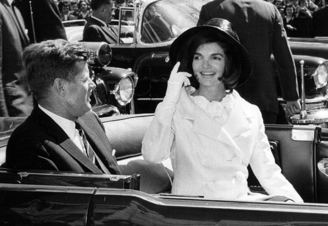 President John F. Kennedy and First Lady Jacqueline Kennedy ride in a parade March 27, 1963 in Washington, DC. (Photo by National Archive/Newsmakers)