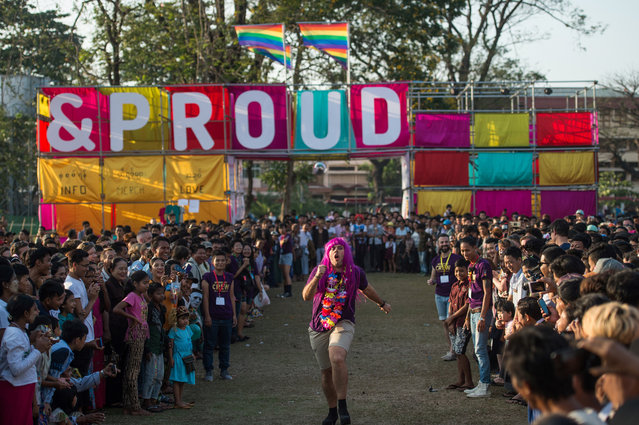 """This photo taken on January 28, 2018 shows a participant (C) running in a high-heel game during the """"&Proud"""" LGBT festival in Yangon. (Photo by Ye Aung Thu/AFP Photo)"""