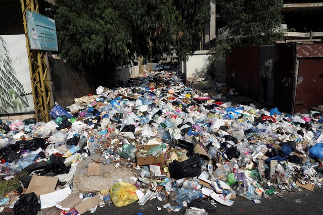 Piled up garbage is seen along a street in Ain el-Remmaneh, Lebanon on September 21, 2020. (Photo by Mohamed Azakir/Reuters)