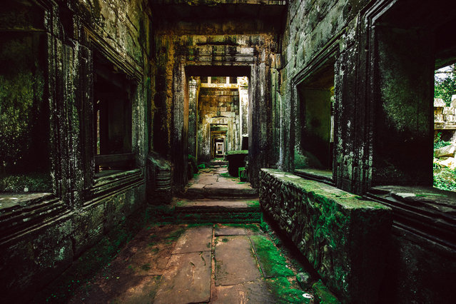 Endless corridors of Preah Khan, one of the largest complexes of Angkor. (Photo by Alex Teuscher/Caters News)