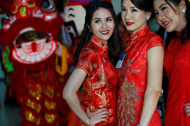 Thai women pose for a photo as they attend a Warm Welcome ceremony to Chinese tourists at Don Mueang International Airport in Bangkok, Thailand February 16, 2018. (Photo by Soe Zeya Tun/Reuters)