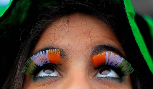 A woman wears false flag eyelashes during the St Patrick's day parade through Dublin city centre on St Patrick's day, on March 17, 2013. (Photo by Julien Behal/PA Wire)