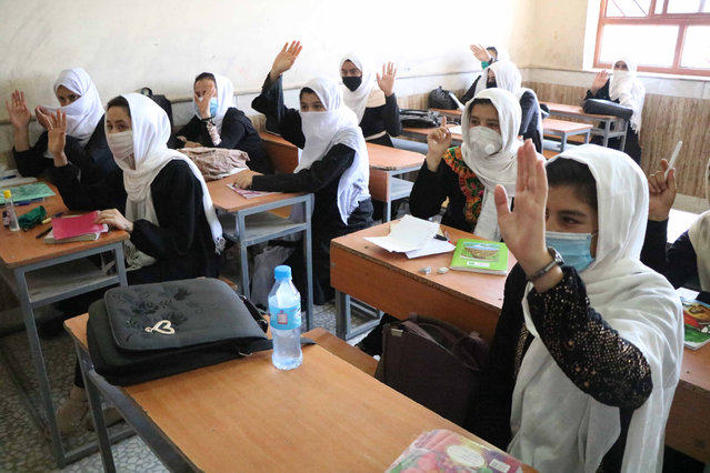 Afghan student girls attend the second day of their school after the educational institutes opened in Herat, Afghanistan, 23 August 2020. Schools reopen across Afghanistan, in a trial following months of closure due to the pandemic. (Photo by Jalil Rezayee/EPA/EFE)