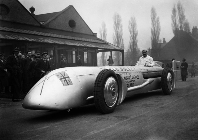 "Kaye Don seated in the cockpit of his new racing car the ""Silver Bullet"" at Wolverhampton, England on February 21, 1930, in which he will attempt to beat world land speed record at Daytona. It has two 12-cylinder V shaped engines and each develops 2,000-h.p. The theoretical speed of the car is 275 m.p.h. but the designer estimated that will be able to reach 250 m.p.h. allowing for wind pressures. (Photo by AP Photo/Staff/Puttnam)"