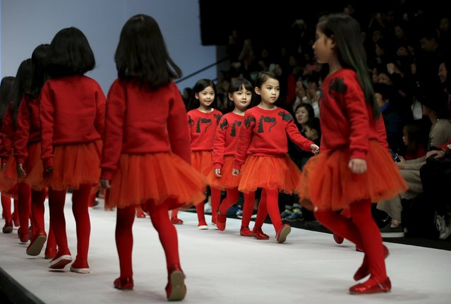 Models present creations for M.latin children's wear collection at China Fashion Week S/S 2016 in Beijing, China, October 28, 2015. (Photo by Jason Lee/Reuters)