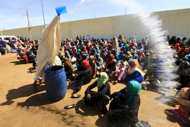 Shaq Boshraa, a spiritual healer, sprinkles water during a sermon at a yard in Khartoum, Sudan, October 30, 2015. (Photo by Mohamed Nureldin Abdallah/Reuters)