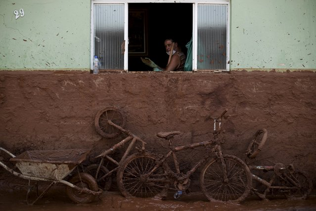 A man works on the cleaning of a house flooded with mud after a dam, owned by Vale SA and BHP Billiton Ltd burst, in Barra Longa, Brazil, November 7, 2015. The death toll from two collapsed dams at a Brazilian mine will surely rise in coming days, a local mayor said on Saturday, as up to 10 residents of the nearest village remain missing in addition to 13 miners. So far one worker has been confirmed dead in what the governor of mineral-rich Minas Gerais described as the state's worst environmental disaster. (Photo by Ricardo Moraes/Reuters)