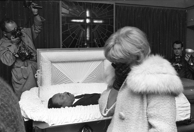 An unidentified woman weeps at the R.S. Lewis funeral home in Memphis, Tenn., as hundreds of mourners filed past the body of civil rights leader Dr. Martin Luther King, Jr., April 5, 1968, before it was to be sent to Atlanta for burial. (Photo by Charles Kelly/AP Photo)
