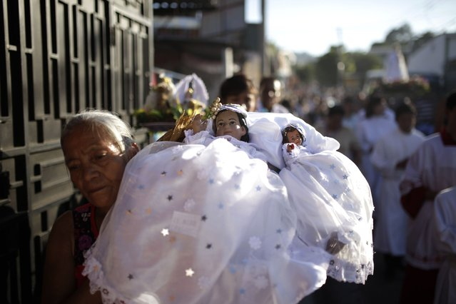 A Catholic faithful holds a figurine of baby Jesus during a religious procession on Holy Innocents Day in Antiguo Cuscatlan, on the outskirts of San Salvador, December 28, 2014. (Photo by Jose Cabezas/Reuters)