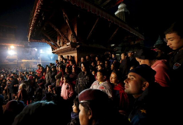 People observe as mediums performs the religious dance during the traditional Kartik dance festival at Patan Durbar Square in Lalitpur, Nepal November 24, 2015. Observed for eight days, the festival is the longest dance festival in Nepal, and features a mix of drama, music and dialogues introduced by King Siddhinarsingh Malla in 1637 AD. (Photo by Navesh Chitrakar/Reuters)