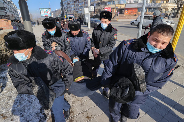 A protester is taken away by law enforcement officers during a rally held by opposition supporters on the parliamentary election day in Almaty, Kazakhstan on January 10, 2021. (Photo by Petr Trotsenko/Radio Free Europe/Radio Liberty)