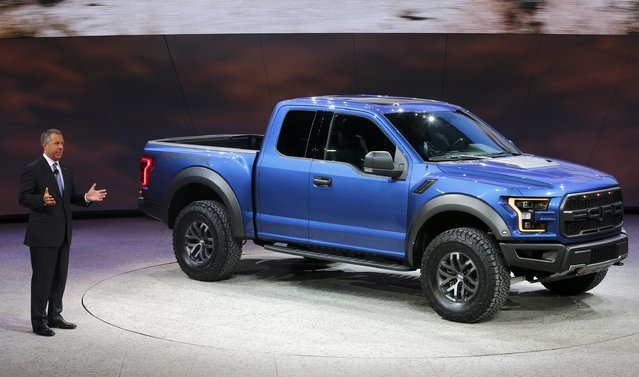 Ford President of the Americas Joe Hinrichs speaks next to a Raptor pickup truck during the first press preview day of the North American International Auto Show in Detroit, Michigan, January 12, 2015. (Photo by Mark Blinch/Reuters)