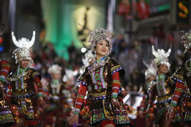 Members of Joyful Parade China, Students' Art Troupe of Guangxi University of Finance and Economics, take part in a march at the 84th Annual Hollywood Christmas Parade in the Hollywood section of Los Angeles, California, November 29, 2015. (Photo by David McNew/Reuters)