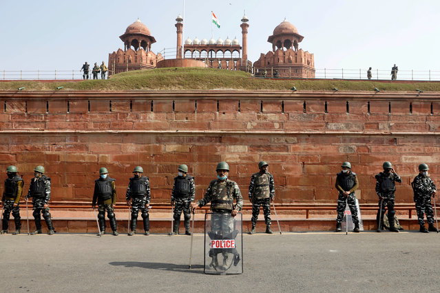 Policemen stand guard in front of the historic Red Fort after Tuesday's clashes between police and farmers, in the old quarters of Delhi, India, January 27, 2021. (Photo by Adnan Abidi/Reuters)