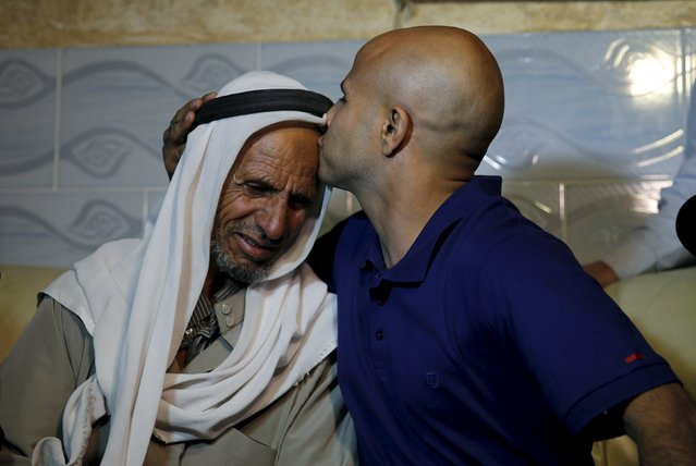 Uda Tarrabin (R) kisses his father Suliman after arriving home following 15 years in Egypt, in the Tarrabin tribe's village near Rahat in southern Israel, December 10, 2015. Egypt has freed Tarrabin, an Israeli-Arab held in its jails for 15 years on espionage charges in exchange for the release of two Egyptians held in Israel, Egyptian and Israeli officials said on Thursday. (Photo by Amir Cohen/Reuters)