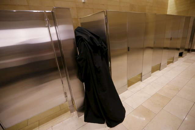 """A man dressed as a character from Star Wars enters the bathroom during an event held for the release of the film """"Star Wars: The Force Awakens"""" at a movie theater in Guatemala City, December 16, 2015. (Photo by Jorge Dan Lopez/Reuters)"""