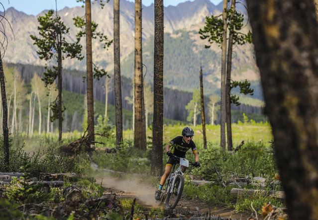 Cole Weathers flies through Lost Lake Trail during the Vail Recreation District's Lost Lake Loop as part of its Wednesday Mountain Bike Race Series, July 11, 2018. in Vail, Colo. (Photo by Chris Dillmann/Vail Daily via AP Photo)