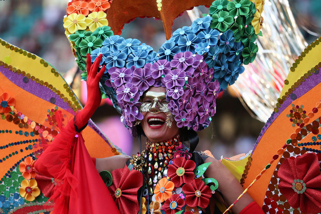A participant celebrates the Sydney Gay and Lesbian Mardi Gras Parade under coronavirus disease (COVID-19) safety guidelines at the Sydney Cricket Ground in Sydney, Australia, March 6, 2021. (Photo by Loren Elliott/Reuters)