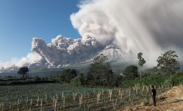 Mount Sinabung spews volcanic materials during an eruption in Karo, North Sumatra, Indonesia, 02 March 2021. The volcano erupted on 02 March, spewing volcanic materials 5,000 meters up in the air. (Photo by Sastrawan Ginting/EPA/EFE)
