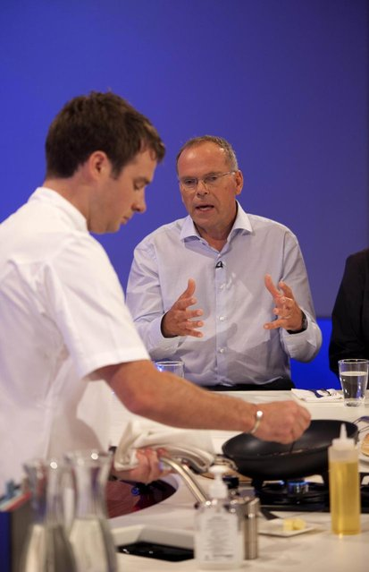 In this handout image provided by Ogilvy, Chef Richard McGeown (L) prepares a burger made from cultured beef, which has been developed by Professor Mark Post of Maastricht University in the Netherlands, (R) at the world's first public tasting of the product on August 5, 2013 in London, England. Cultured Beef could help solve the coming food crisis and combat climate change with commercial production of Cultured Beef beginning within ten to twenty years. (Photo by David Parry via Getty Images)