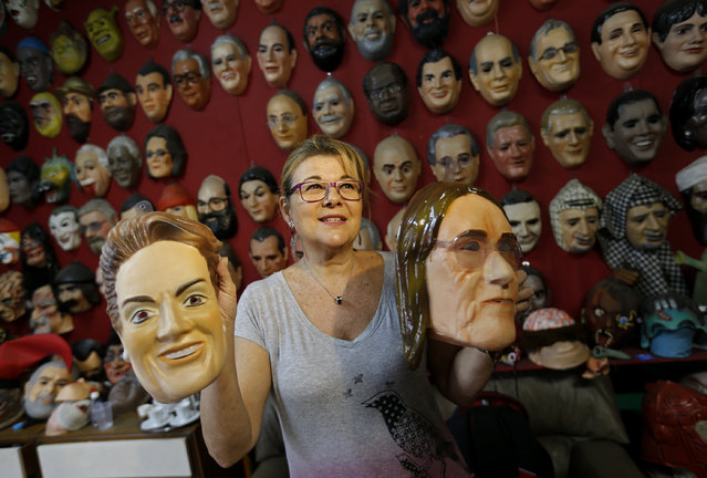 Olga Valles shows carnival masks in the likeness of former  Petrobras' CEO Maria das Gracas Foster, right, and Brazil's President Dilma Rousseff at the Condal factory in Rio de Janeiro, Brazil, Friday, February 6, 2015. Brazil's state oil company is in crisis amid an expanding corruption investigation into a long-running kickback scheme on its contracts, forcing the resignation of das Gracas Foster and making her mask a popular item. (Photo by Silvia Izquierdo/AP Photo)