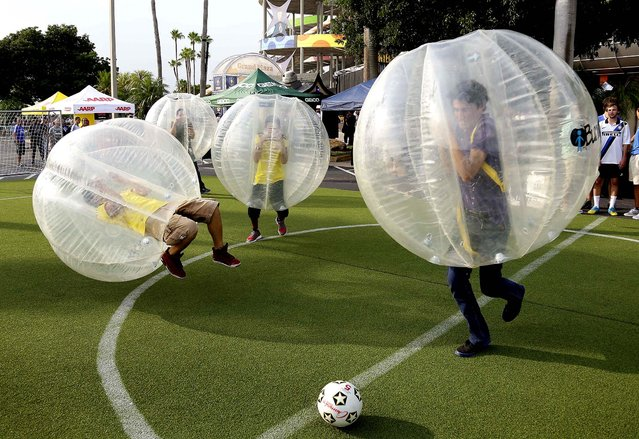 Fans play bubble soccer before the start  of the Guinness International Champions Cup game between Juventus and Inter Milan in Miami, on August 6, 2013. (Photo by J. Pat Carter/Associated Press)