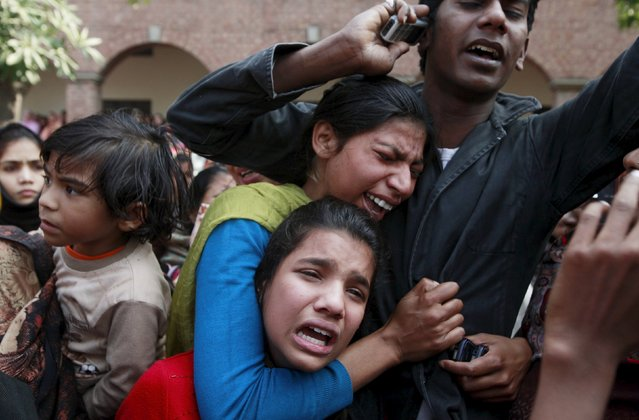 Women from the Christian community mourn for a relative, who was one of the victims killed by a suicide attack on a church, during his funeral in Lahore, Pakistan March 17, 2015. (Photo by Mohsin Raza/Reuters)